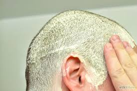 head lice treatments showing a shaved head